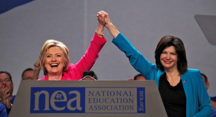 Democratic presidential candidate Hillary Clinton clasps hands with NEA President Lily Eskelsen Garcia at the NEA's 95th Representative Assembly in Washington on July 5. (Photo: Kevin Lamarque/Reuters)