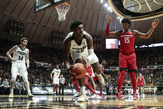 Purdue forward Trevion Williams (50) saves a rebound from going out of bounds in front of Rutgers center Myles Johnson (15) during the first half of an NCAA college basketball game in West Lafayette, Ind., Tuesday, Jan. 15, 2019. (AP Photo/AJ Mast)
