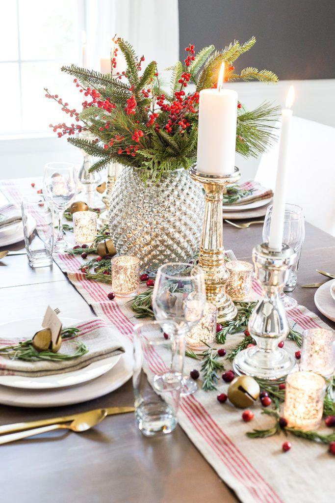 """<p>Mercury glass, candles, a burlap table runner, and fresh cranberries come together to make this elegant red and green tablescape. </p><p><em><a href=""""https://www.blesserhouse.com/mercury-glass-christmas-tablescape/"""" rel=""""nofollow noopener"""" target=""""_blank"""" data-ylk=""""slk:Get the tutorial at Bless'er House »"""" class=""""link rapid-noclick-resp"""">Get the tutorial at Bless'er House »</a></em></p>"""