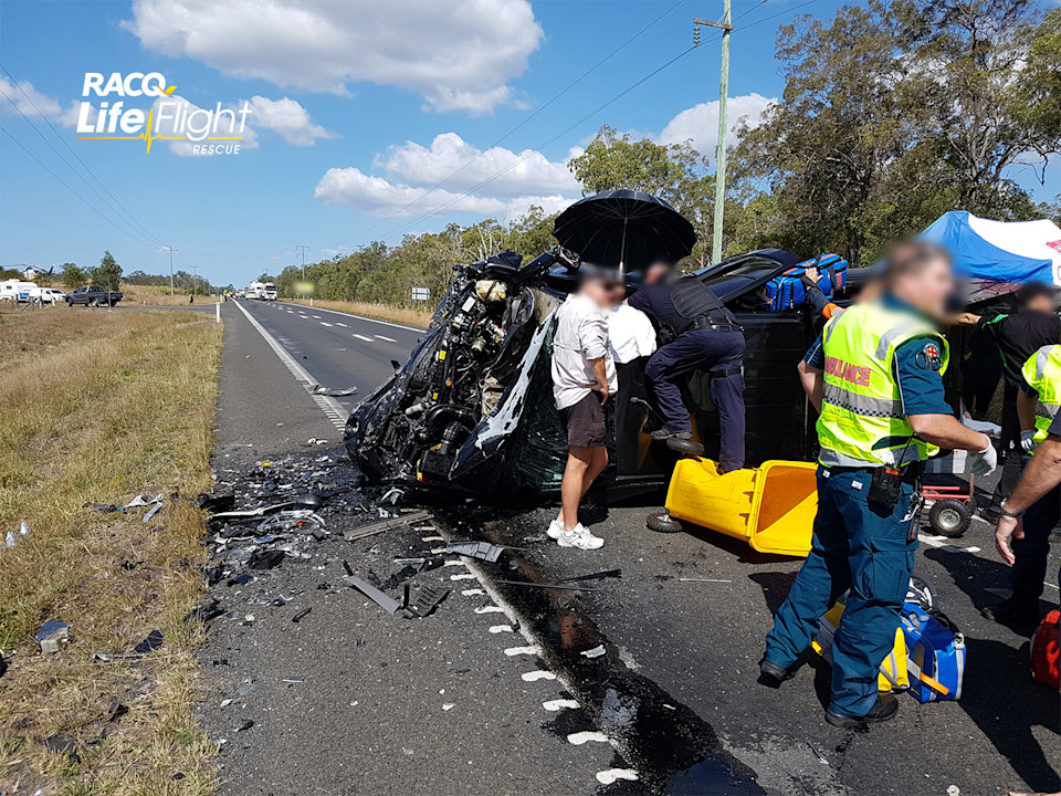 Paramedics and police at the scene of a crash at South Isis in 2018.