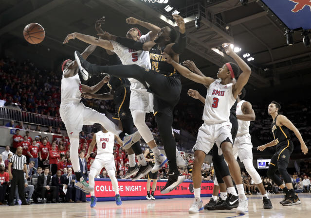Southern Methodist forward Ethan Chargois (5) and Wichita State center Shaquille Morris (24) compete for a rebound as guard William Douglas (3) watches in the first half of an NCAA college basketball game Saturday, Feb. 24, 2018, in Dallas. (AP Photo/Tony Gutierrez)
