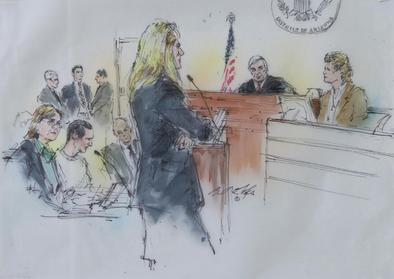 In this courtroom sketch, from left, Attorney Judy Clark sits with her client, Jared Lee Loughner as U.S. District Judge Larry Burns listens from the bench to testimony from Dr. Christina PIetz, far right, in federal court Wednesday, Sept. 28, 2011 in Tucson, Ariz. Suspected shooter Jared Loughner, who is charged with shooting U.S. Rep. Garbrielle Giffords, D-Ariz., and 18 others in January, was in court to face a mental competency hearing. (AP Photo/Bill Robles)