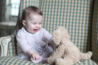 <p>Ever the photographer, Kate takes a super cute photo of a six-month-old Charlotte with her favourite cuddly toy.<br><i>[Photo: PA]</i> </p>