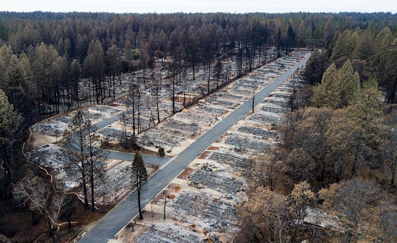 Homes leveled by the Camp fire in a mobile home park in Paradise, California, Dec. 3, 2018. The blaze was the world's costliest natural disaster last year, at $16.5 billion in losses, according to Munich Re. (Photo: ASSOCIATED PRESS)