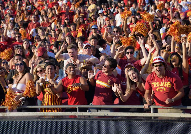 LOS ANGELES, CA - NOVEMBER 23: USC Trojans fans celebrate in the USC student section during the fourth quarter of a college football game against the UCLA Bruins played on November 23, 2019 at the Los Angeles Memorial Coliseum in Los Angeles, CA. (Photo by John Cordes/Icon Sportswire via Getty Images)