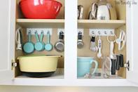 """<p>These frequently-accessed kitchen helpers are always in reach when you pop them on hooks. Is there any problem that can't be solved with hooks?</p><p><a href=""""http://www.twotwentyone.net/organized-baking-cabinet/"""" rel=""""nofollow noopener"""" target=""""_blank"""" data-ylk=""""slk:See more at Two Twenty One »"""" class=""""link rapid-noclick-resp""""><em>See more at Two Twenty One »</em></a></p>"""