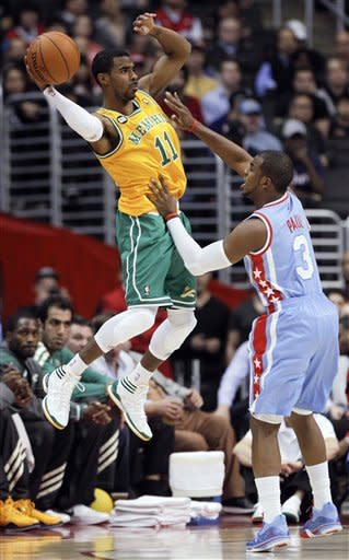 Memphis Grizzlies guard Mike Conley, left, passes over Los Angeles Clippers guard Chris Paul during the first half of an NBA basketball game in Los Angeles, Thursday, Jan. 26, 2012. (AP Photo/Chris Carlson)