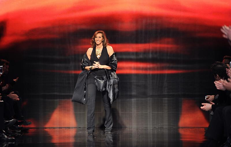 Designer Donna Karan greets the audience after the Donna Karan New York Fall 2014 collection was presented during Fashion Week, Monday, Feb. 10, 2014, at 23 Wall Street in New York. (AP Photo/Diane Bondareff)