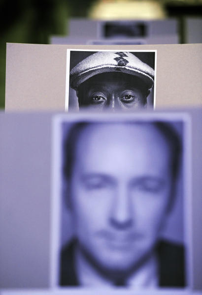 A placard of actor Don Cheadle peers out from behind a placard of actor Kevin Spacey in the audience during the 65th Emmy Awards Press Preview Day, on Wednesday, Sept. 18, 2013, at Nokia Theatre in Los Angeles. (Photo by Chris Pizzello/Invision/AP)