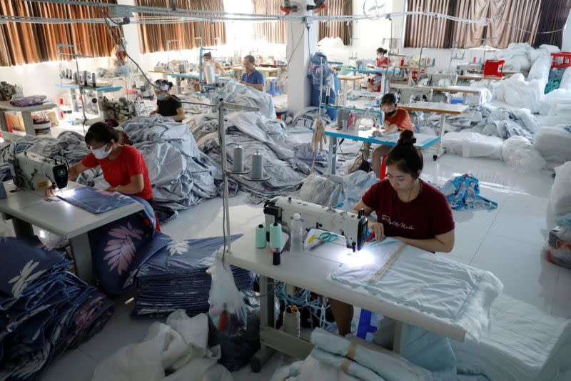 Labourers work at a private factory after government eased nationwide lockdown following the coronavirus disease (COVID-19) in Hanoi