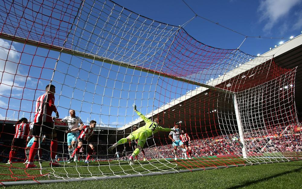 Collins puts West Ham back in front with a header from a corner - Credit: Ian MacNicol/Getty Images