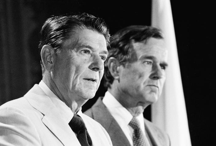 <p>Republican candidate for president Ronald Reagan, left, and his running mate, George Bush, answer questions during a press conference on July 26, 1980. (Photo: Wally Fong/AP) </p>