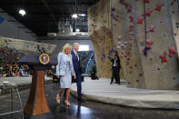 President Joe Biden leaves with first lady Jill Biden after speaking at Sportrock Climbing Centers, Friday, May 28, 2021, in Alexandria, Va. (AP Photo/Evan Vucci)