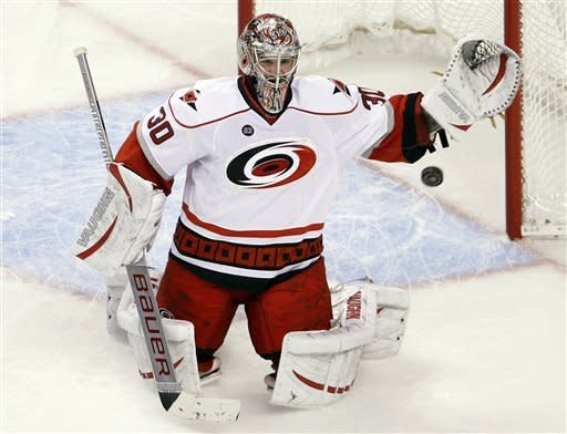 Carolina Hurricanes goalie Cam Ward watches the puck on a save against the Boston Bruins during the third period of an NHL hockey game in Boston, Thursday Feb. 2, 2012. (AP Photo/Charles Krupa)