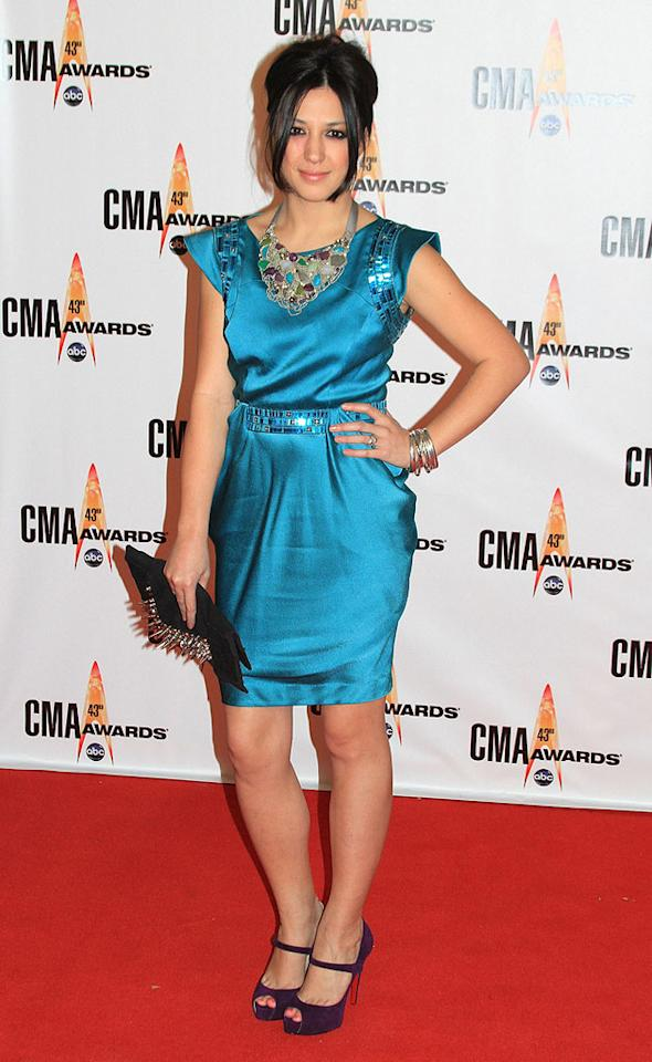 """Michelle Branch  Grade: B  The Grammy winner successfully accessorized her turquoise cocktail frock with a statement necklace, purple pumps, and spiky clutch. Taylor Hill/<a href=""""http://www.wireimage.com"""" target=""""new"""">WireImage.com</a> - November 11, 2009"""
