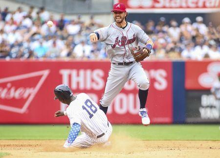 Jul 4, 2018; Bronx, NY, USA; New York Yankees shortstop Didi Gregorius (18) slides into Atlanta Braves shortstop Dansby Swanson (7) trying to break up a double play in the eighth inning at Yankee Stadium. Mandatory Credit: Wendell Cruz-USA TODAY Sports