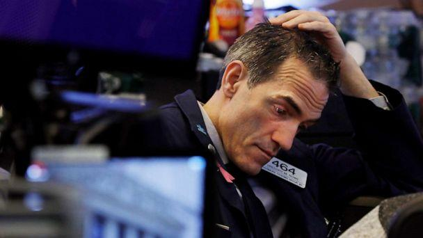 PHOTO: Trader Gregory Rowe prepares for the day's activity on the floor of the New York Stock Exchange, March 9, 2020. (Richard Drew/AP)