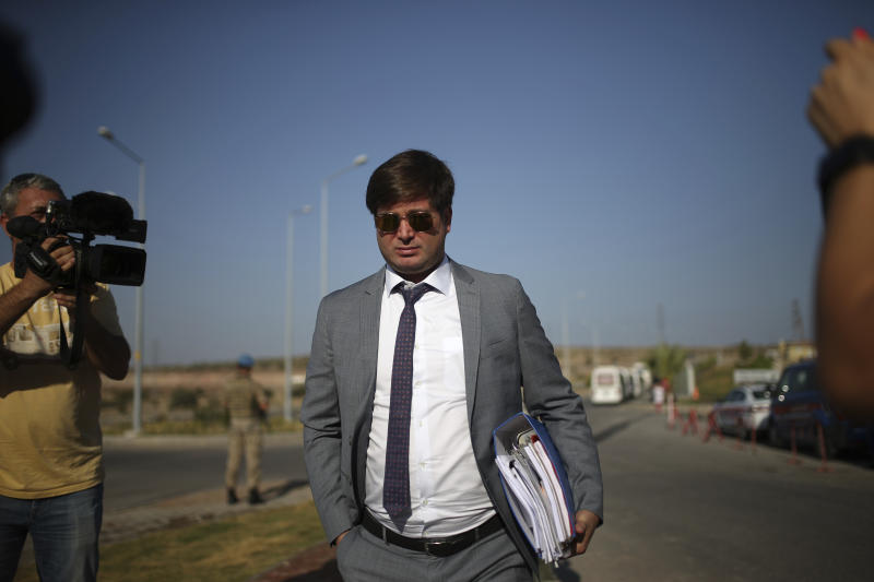 """Ismail Cem Halavurt, the lawyer of jailed Andrew Craig Brunson who served as the pastor in Izmir, western Turkey, arrives at the prison complex in Aliaga, Izmir province, western Turkey, where his client is appearing on his trial at a court inside the complex, Wednesday, July 18, 2018. The 50-year-old evangelical pastor from Black Mountain, North Carolina, faces up 35 years in prison in Turkey on charges of """"committing crimes on behalf of terror groups without being a member"""" and """"espionage."""" (AP Photo/Emre Tazegul)"""