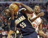 Indiana Pacers center Roy Hibbert, left, rebounds a ball against Chicago Bulls guard Jimmy Butler during the first half of an NBA basketball game in Chicago on Saturday, March 23, 2013. (AP Photo/Nam Y. Huh)