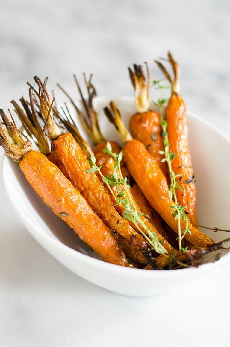 "<p>With so many time-consuming dishes to make, you've got to have a few that are nice and simple. These roasted carrots will do the trick!</p><p><strong><a href=""https://www.thepioneerwoman.com/food-cooking/cooking-tips-tutorials/a90292/6-ways-to-elevate-roasted-carrots/"" rel=""nofollow noopener"" target=""_blank"" data-ylk=""slk:Get the recipe."" class=""link rapid-noclick-resp"">Get the recipe.</a> </strong></p><p><strong><a class=""link rapid-noclick-resp"" href=""https://go.redirectingat.com?id=74968X1596630&url=https%3A%2F%2Fwww.walmart.com%2Fbrowse%2Fhome%2Fbaking-dishes%2F4044_623679_8455465_2321543%3Ffacet%3Dbrand%253AThe%2BPioneer%2BWoman&sref=https%3A%2F%2Fwww.thepioneerwoman.com%2Ffood-cooking%2Fmeals-menus%2Fg33251890%2Fbest-thanksgiving-sides%2F"" rel=""nofollow noopener"" target=""_blank"" data-ylk=""slk:SHOP BAKING DISHES"">SHOP BAKING DISHES</a><br></strong></p>"