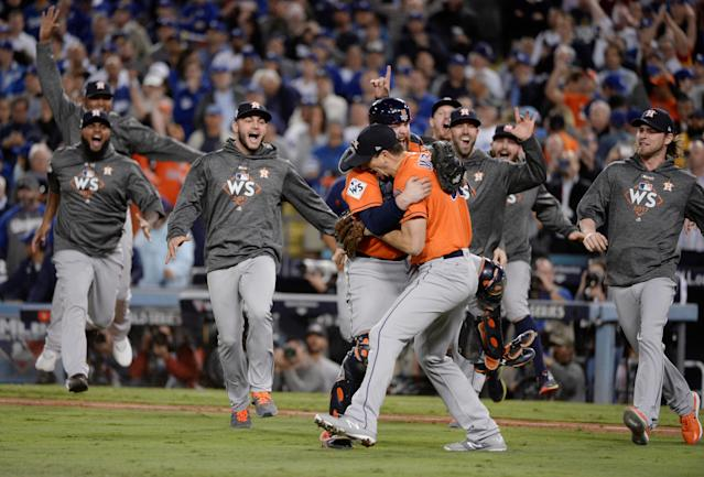 Houston Astros players celebrate after defeating the LA Dodgers in game seven of the 2017 World Series at Dodger Stadium. (Gary A. Vasquez-USA TODAY)