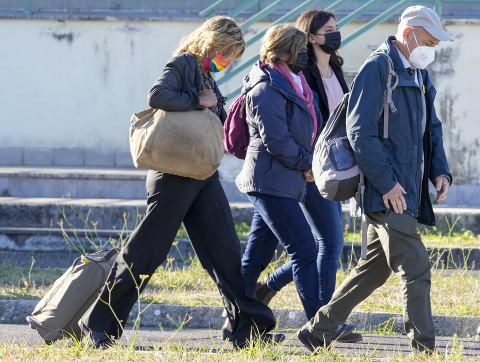 The family of slain Italian doctoral student Giulio Regeni, from left, mother Paola Deffendi, Giulio's sister Irene, and father Claudio Regeni arrive with their lawyer Alessandra Ballerini at the Rebibbia prison in Rome, Thursday, Oct. 14, 2021, to attend the first hearing of the trial for the death of Italian doctoral student Giulio Regeni, who disappeared for several days in January 2016 before his body was found on a desert highway north of the Egyptian capital. Italian prosecutors have formally put four high-ranking members of Egypt's security forces under investigation for their alleged roles in the slaying. (AP Photo/Andrew Medichini)