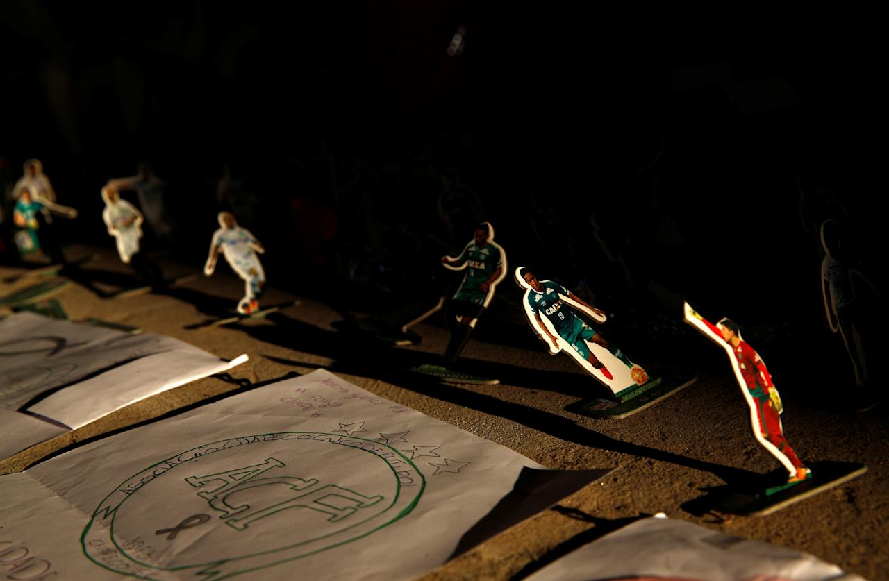 A drawing lies next to cutouts of players of Chapecoense soccer team during a tribute at the Arena Conda stadium in Chapeco, Brazil December 1, 2016. REUTERS/Ricardo Moraes