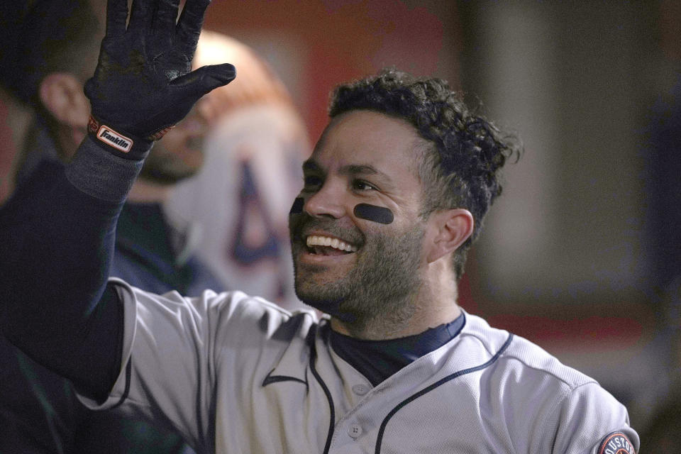 Houston Astros' Jose Altuve celebrates in the dugout with teammates after hitting a solo home run against the San Francisco Giants during the fifth inning of a baseball game Friday, July 30, 2021, in San Francisco. (AP Photo/Tony Avelar)