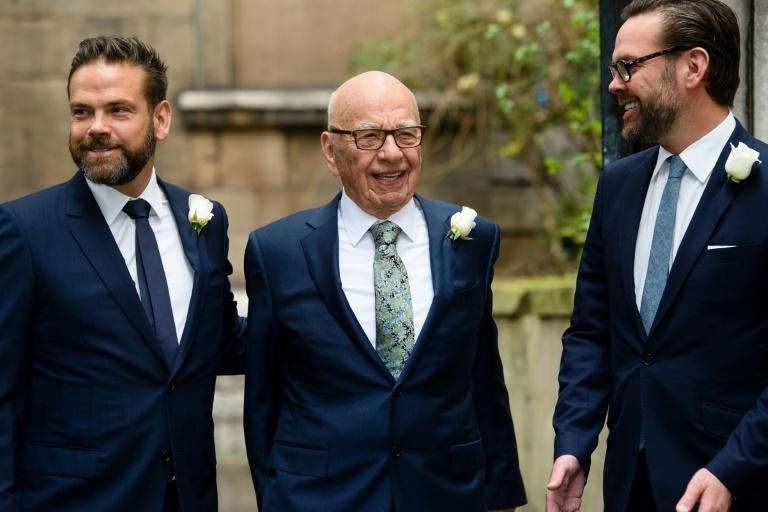 Rupert Murdoch (C) with his sons Lachlan (L) and James (R)