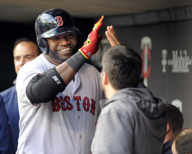 Boston Red Sox David Ortiz (34), left, celebrates after hitting a solo home run against Minnesota Twins pitcher Ricky Nolasco during the first inning of a baseball game in Minneapolis, Tuesday, May, 13, 2014.(AP Photo/Craig Lassig)