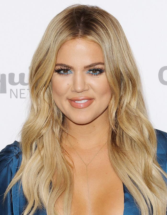 <br>While most of her sisters have gone for the chop this year, Khloe Kardashian has continued to sport her long blonde locks.