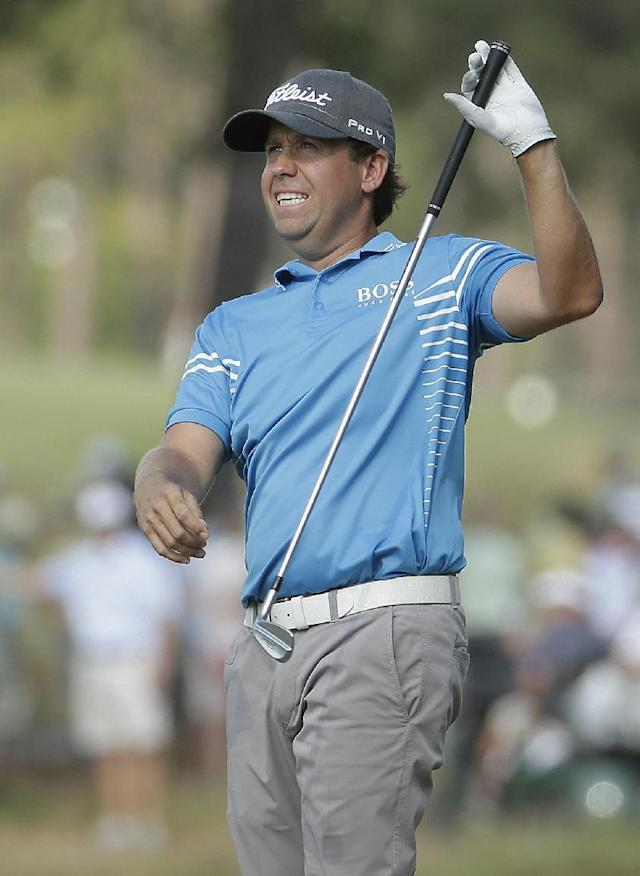 Erik Compton reacts to his second shot on the 13th hole during the third round of the U.S. Open golf tournament in Pinehurst, N.C., Saturday, June 14, 2014. (AP Photo/Charlie Riedel)