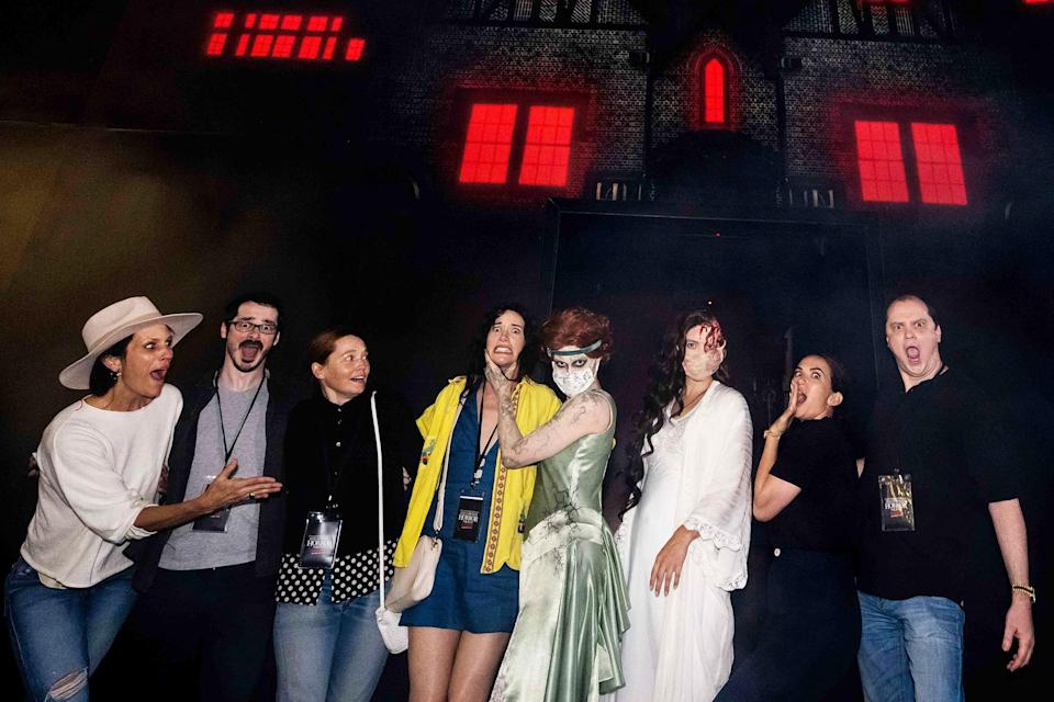 <p>visiting their maze at Halloween Horror Nights at Universal Studios Hollywood on Sept. 11.</p>