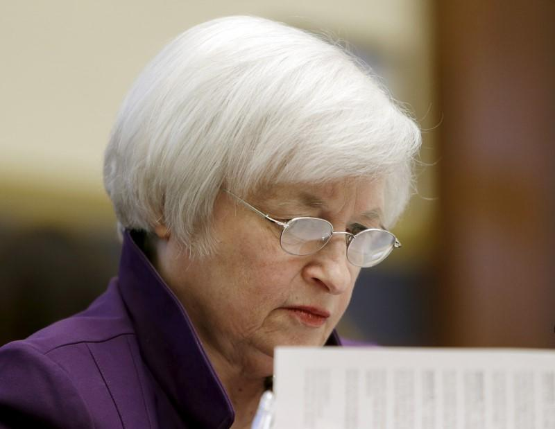 Federal Reserve Board Chair Yellen checks notes at House Financial Services Committee in Washington