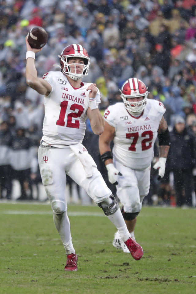 Indiana quarterback Peyton Ramsey (12) throws a pass for a touchdown against Purdue during the first half of an NCAA college football game in West Lafayette, Ind., Saturday, Nov. 30, 2019. (AP Photo/Michael Conroy)
