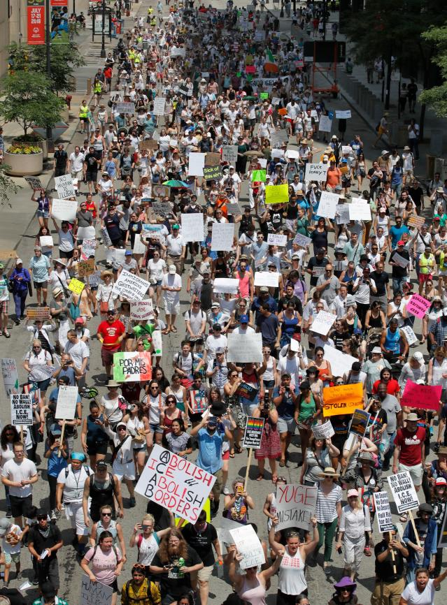 <p>Protestors march through the streets during a demonstration against the US immigration policies separating migrant families in Chicago, June 30, 2018. (Photo: Jim Young/AFP/Getty Images) </p>