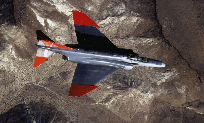 In this undated photo provided by the U.S. Air Force, a QF-4 Drone is in flight as it is tracked by a missile at Tyndall AFB, Fla. A remote stretch of a Florida Panhandle highway is closed Wednesday, July 17, 2013 after an Air Force drone crashed near the area. Tyndall Air Force Base says the QF-4 drone crashed on takeoff early Wednesday. No one was injured in the crash. (AP Photo/U.S. Air Force)