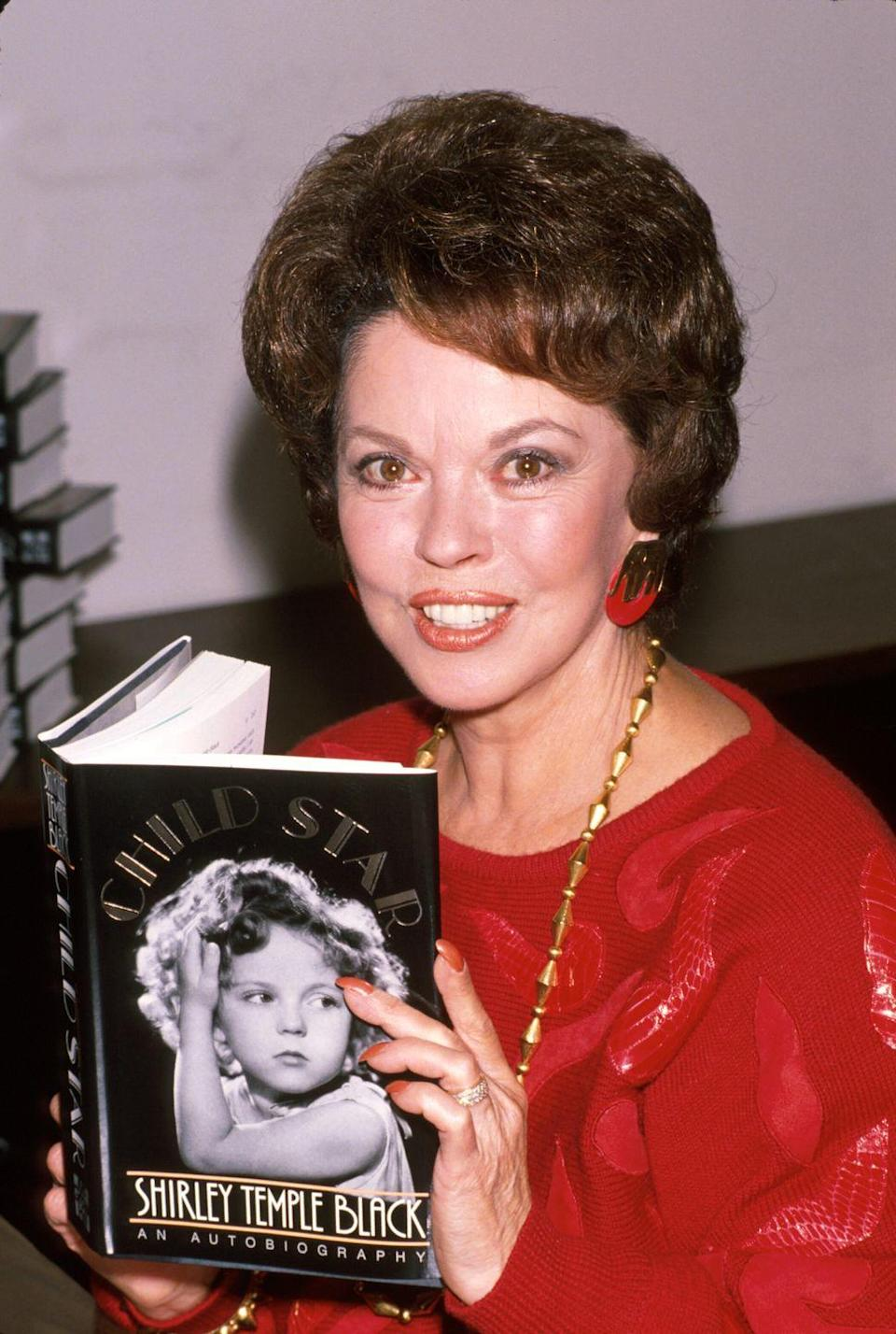 """<p>In 1988, the former child star released her autobiography, <a href=""""https://www.amazon.com/Child-Star-Shirley-Temple-Black/dp/0070055327?tag=syn-yahoo-20&ascsubtag=%5Bartid%7C10063.g.35392518%5Bsrc%7Cyahoo-us"""" rel=""""nofollow noopener"""" target=""""_blank"""" data-ylk=""""slk:Child Star: An Autobiography"""" class=""""link rapid-noclick-resp""""><em>Child Star: An Autobiography</em></a>. In it she detailed her time as the number one box office star in America, her relationship with her parents (<a href=""""https://www.cnn.com/2014/02/11/showbiz/movies/shirley-temple-child-star-appreciation/index.html"""" rel=""""nofollow noopener"""" target=""""_blank"""" data-ylk=""""slk:they &quot;showered her&quot; in love"""" class=""""link rapid-noclick-resp"""">they """"showered her"""" in love</a>), and her decision to retire at the age of 22. </p>"""