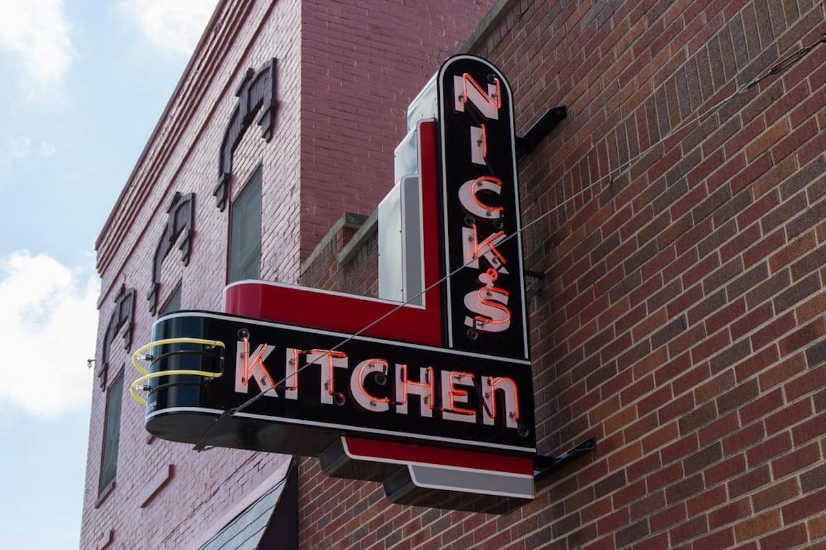 """<p>In 1904, Nick Freienstein began selling hamburgers at night from a pushcart with a dim lantern on the courthouse square in Huntington, Indiana. It became so popular that he built a 10-by-10 structure under a stairway at a street corner. Then in 1908, he moved into the present brick-and-mortar location. Though the burgers still hold true, the pork tenderloin sandwich, a <a href=""""https://www.thedailymeal.com/recipe/game-day-recipes-football?referrer=yahoo&category=beauty_food&include_utm=1&utm_medium=referral&utm_source=yahoo&utm_campaign=feed"""">game-day favorite</a> from Indiana, is a menu standout. It's made with the same recipe Freienstein used.</p>"""