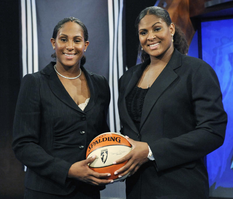 Oklahoma's twin sisters Ashley, left, and Courtney Paris pose before the WNBA draft Thursday, April 9, 2009 in Secaucus, N.J. Courtney was picked by the Sacramento Monarchs with the seventh pick overall and Ashley went to the Los Angeles Sparks in the second round with the 22nd pick. (AP Photo/Bill Kostroun)