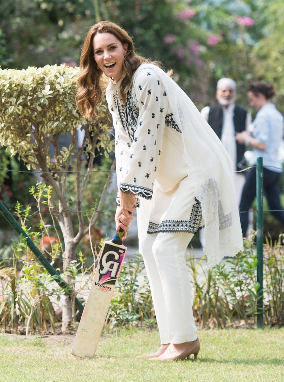<p>The Duchess of Cambridge takes part in a game of cricket as she visits SOS Children's Village. She wore a a traditional kurta by Élan. </p>