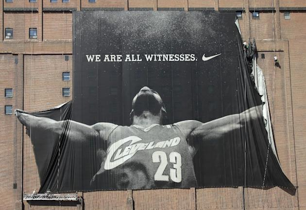 A 10-story banner of LeBron James is taken down by workers in downtown Cleveland on July 11, 2010. (AP/Amy Sancetta)
