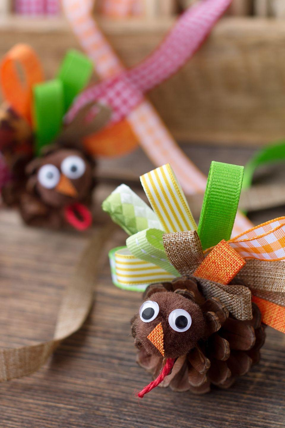 "<p>Use ribbon and any pine cones you find in your yard to make these sweet turkeys that can be used for place card holders.</p><p><strong>Get the tutorial at <a href=""https://www.firefliesandmudpies.com/scrap-ribbon-pinecone-turkeys/"" rel=""nofollow noopener"" target=""_blank"" data-ylk=""slk:Fireflies and Mudpies"" class=""link rapid-noclick-resp"">Fireflies and Mudpies</a>.</strong></p><p><strong><a class=""link rapid-noclick-resp"" href=""https://www.amazon.com/BakeBaking-GHRD-Assortment-Decorations-Collection/dp/B0716WC7L9/ref=sr_1_1?tag=syn-yahoo-20&ascsubtag=%5Bartid%7C10050.g.22626432%5Bsrc%7Cyahoo-us"" rel=""nofollow noopener"" target=""_blank"" data-ylk=""slk:SHOP RIBBON"">SHOP RIBBON</a><br></strong></p>"
