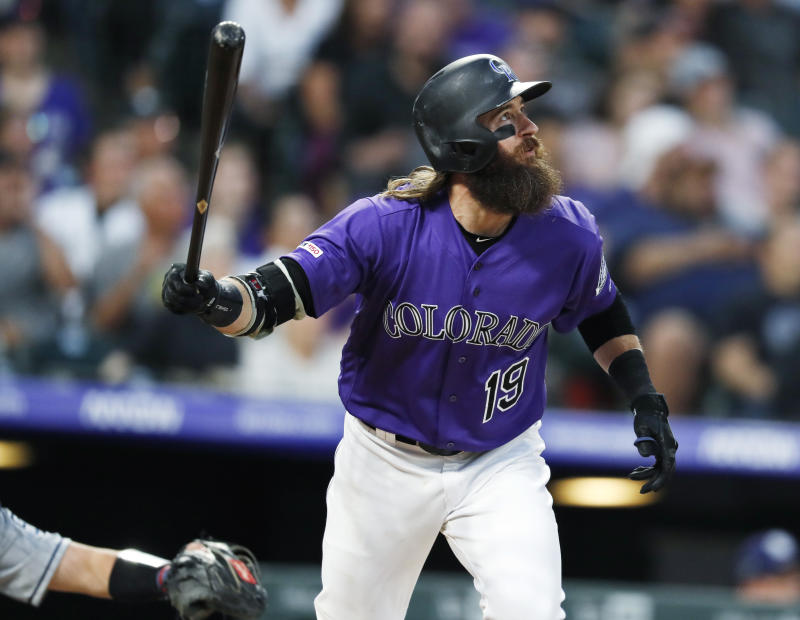 Colorado Rockies' Charlie Blackmon watches his solo home run off San Diego Padres starting pitcher Matt Strahm during the fourth inning of a baseball game Thursday, June 13, 2019, in Denver. (AP Photo/David Zalubowski)