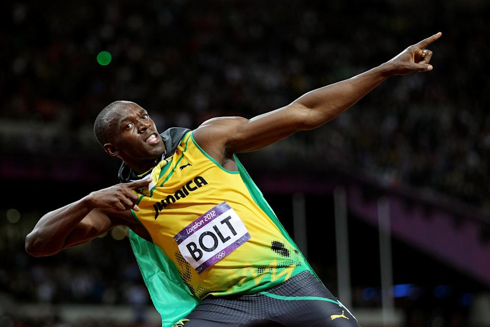 LONDON, ENGLAND - AUGUST 05: Usain Bolt of Jamaica celebrates winning gold in the Men's 100m Final on Day 9 of the London 2012 Olympic Games at the Olympic Stadium on August 5, 2012 in London, England. (Photo by Michael Steele/Getty Images)