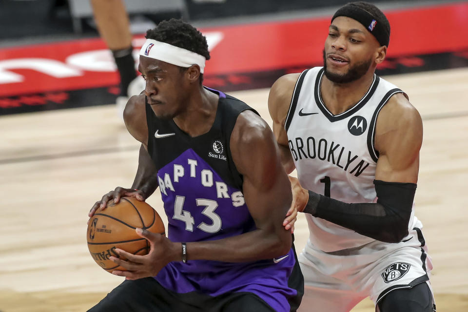 Toronto Raptors' Pascal Siakam, left, is defended by Brooklyn Nets' Bruce Brown during the second half of an NBA basketball game Wednesday, April 21, 2021, in Tampa, Fla. The Raptors won 114-103. (AP Photo/Mike Carlson)