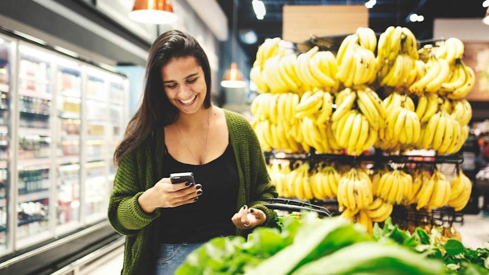 Young woman buying food in a supermarket.