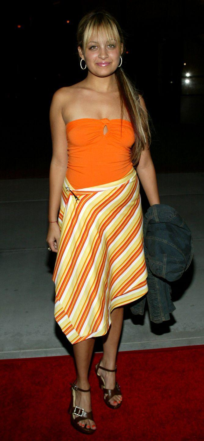 <p><em>The Simple Life</em> star was your orange crush at the Fox Summer Press Tour in a bright tube top and matching striped skirt, held in place with a shooting-star brooch.</p>