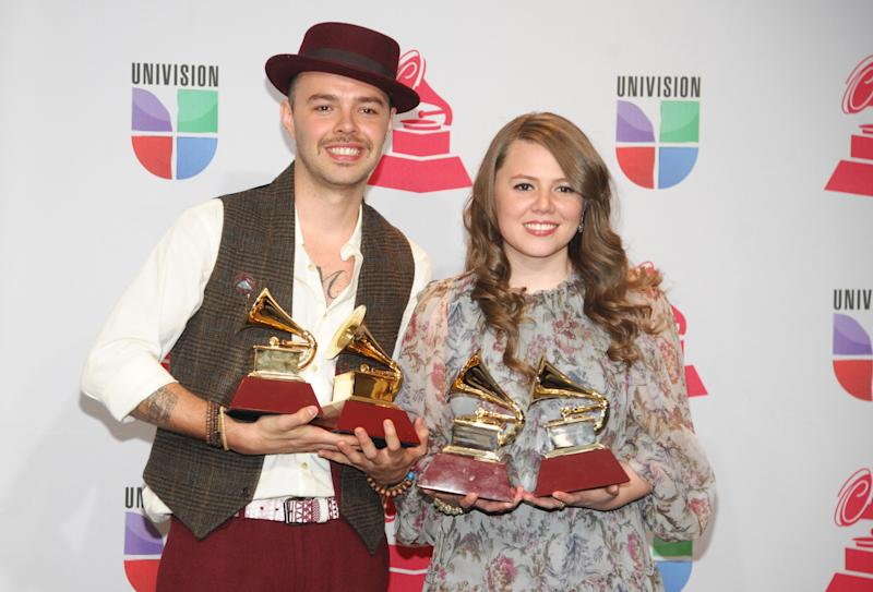 """Jesse & Joy pose backstage with the best contemporary pop vocal album award for """"Con Quien Se Queda el Perro"""" and song of the year for """"Corre!"""" at the 13th Annual Latin Grammy Awards at Mandalay Bay on Thursday, Nov. 15, 2012, in Las Vegas. (Photo by Brenton Ho/Powers Imagery/Invision/AP)"""