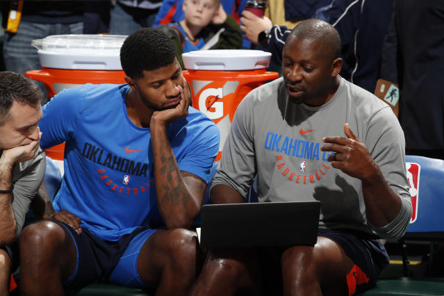 "Adrian Griffin, right, works with the Thunder's <a class=""link rapid-noclick-resp"" href=""/nba/players/4725/"" data-ylk=""slk:Paul George"">Paul George</a> in December. (Getty)"